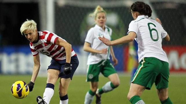 Niamh Fahey puts pressure on USA's Megan Rapinoe in Portland