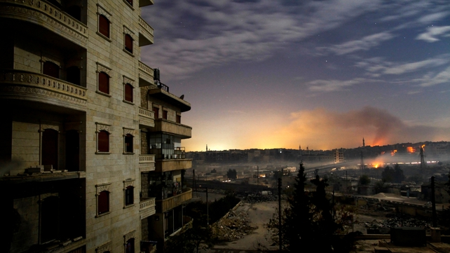 Smoke rises in the northern city of Aleppo on 1 December, as fighting continues through the night