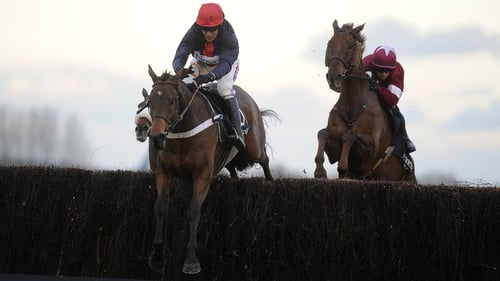 Barry Geraghty and Bobs Worth jump the last on their way to winning the Hennessy