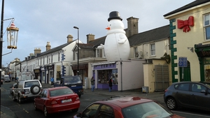 The snowman is back on the roof of the shop (Pic: Micheal Mac Suibhne)