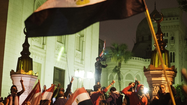 Thousands of demonstrators protest outside the Egyptian presidential palace