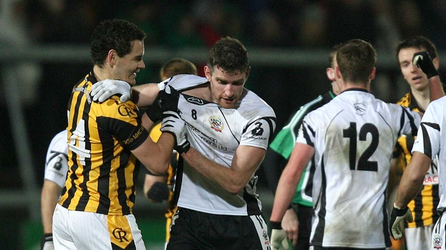 Aaron Cunningham of Crossmaglen  Rangers (left) with Paul Greenan of Kilcoo during the Ulster Club SFC final
