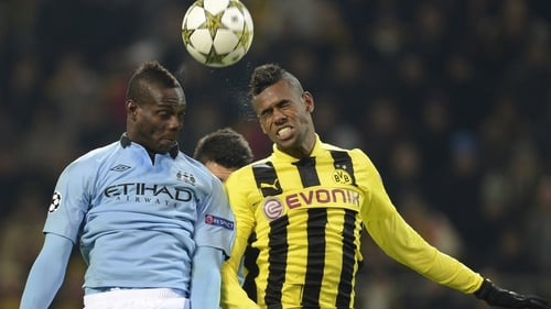 Mario Balotelli (left) and Dortmund's Brazil defender Felipe Santana
