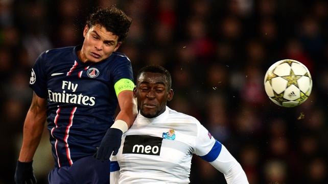 PSG's Thiago Silva (L) vies with Porto's forward Jackson Martinez