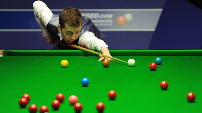 Luca Brecel was three frames behind before coming back to win 6-4