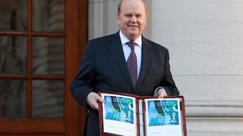 Michael Noonan posed for photographers outside Government Buildings