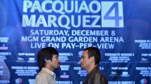 Manny Pacquiao (L) and Juan Manuel Marquez (R) face off at a press conference