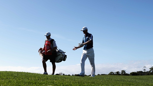 John Senden and his caddie during round one