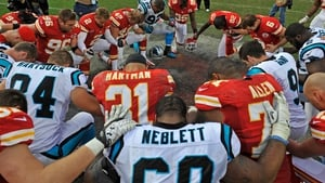 Kansas City Chiefs and Carolina Panthers players pray after a game -  earlier, Chiefs linebacker Jovan Belcher murdered his girlfriend before shooting himself