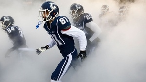 Michael Matson (81) of the Connecticut Huskies runs onto the field with his teammates ahead of the game against the Cincinnati Bearcats