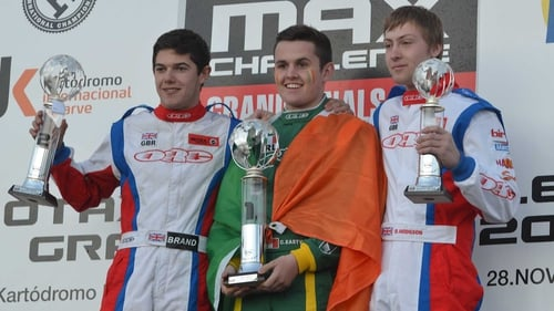 Charlie Eastwood on the podium with Edward Brand left (L) and Oliver Hodgson (R)
