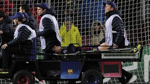 Lionel Messi of Barcelona is injured and carted off during their Champions League match with Benfica