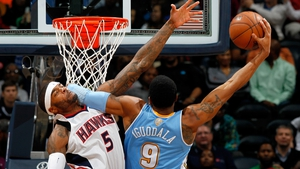 Andre Iguodala of the Denver Nuggets dunks and draws a foul from Josh Smith of the Atlanta Hawks