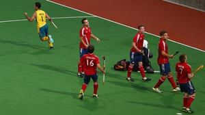 Jamie Dwyer of Australia celebrates after he scores the opening goal against England in the Champions Trophy