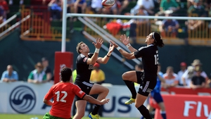 Ben Lam and Scott Curry of New Zealand both climb for the ball as Miguel Lucas of Portugal looks on during the Dubai Cup Sevens