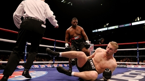 Andrew Flintoff hits the canvas while Richard Dawson looks on during their International Heavyweight bout Manchester, Flintoff won the four-round fight on points
