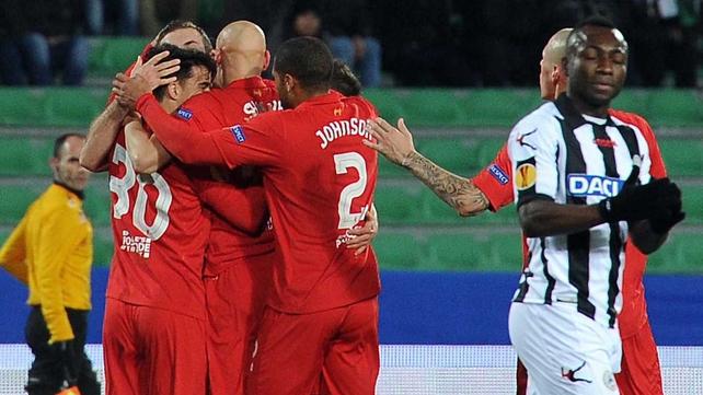 Liverpool player mob Jordan Henderson following his first European goal
