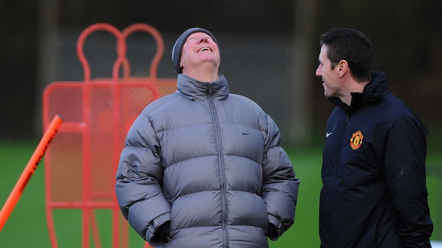 Alex Ferguson shares a joke during a training session this week at Carrington