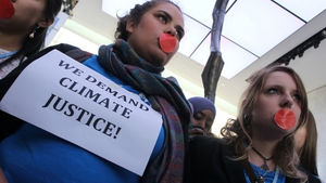 Local and international activists to demanded urgent action to address climate change at the UN climate talks in Doha