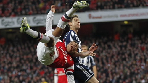 Arsenal striker Alex Oxlade-Chamberlain tries the spectacular against West Brom