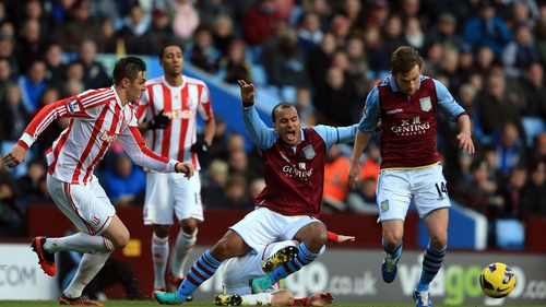 Gabriel Agbonlahor is fouled by Stoke's Geoff Cameron as Brett Holman comes away with the ball at Villa Park
