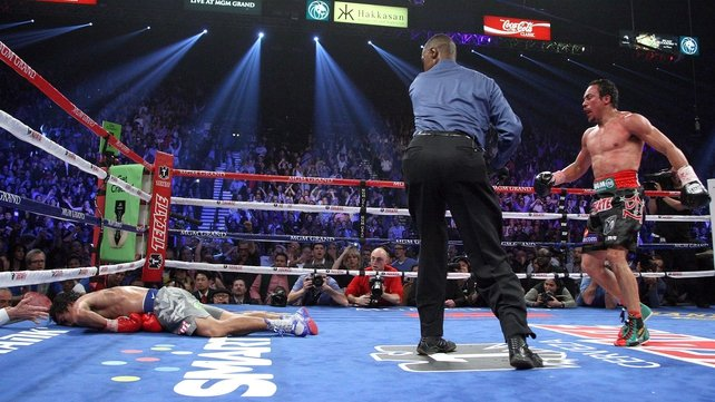 Manny Pacquaio lies on the canvas after being hit by a stunning counter-punch from Juan Manuel Marquez