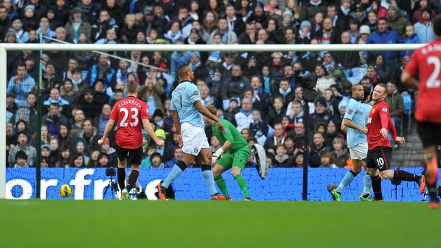 Harte can only look on as Rooney opens the scoring in United's 3-2 win over their city rivalss