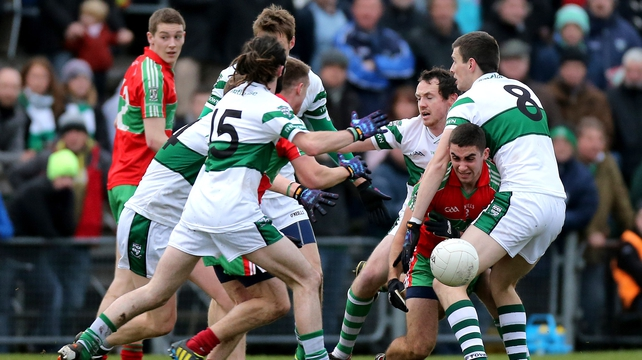 Portlaoise (green and white) always played second fiddle to the new football champions Ballymun Kickhams