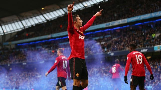 Robin Van Persie celebrates scoring the winning goal
