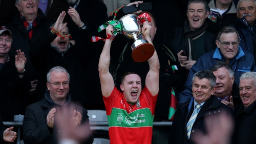 Davy Byrne lifts the winning trophy for the north Dublin side