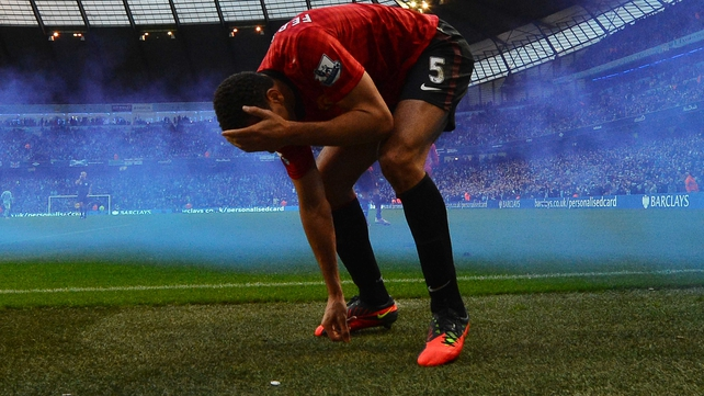 Rio Ferdinand was hit as he celebrated Robin van Persie's late winner