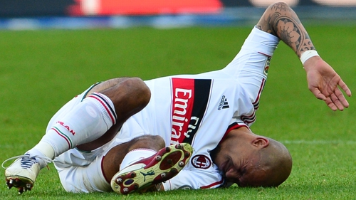 Nigel De Jong reacts in pain after injuring his Achilles