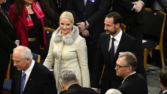 Crown Princess Mette Marit of Norway and Crown Prince Haakon of Norway arrive to attend the Nobel Peace Prize awarding ceremony at the City Hall in Oslo