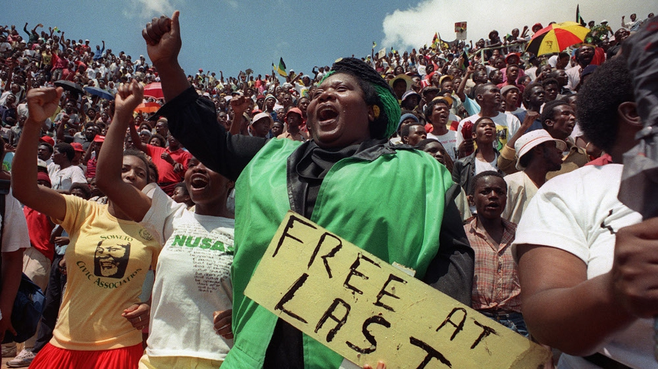 Jubilant inhabitants of Soweto attend a mass ANC event to be addressed by Nelson Mandela at Orlando stadium in Soweto in 1990