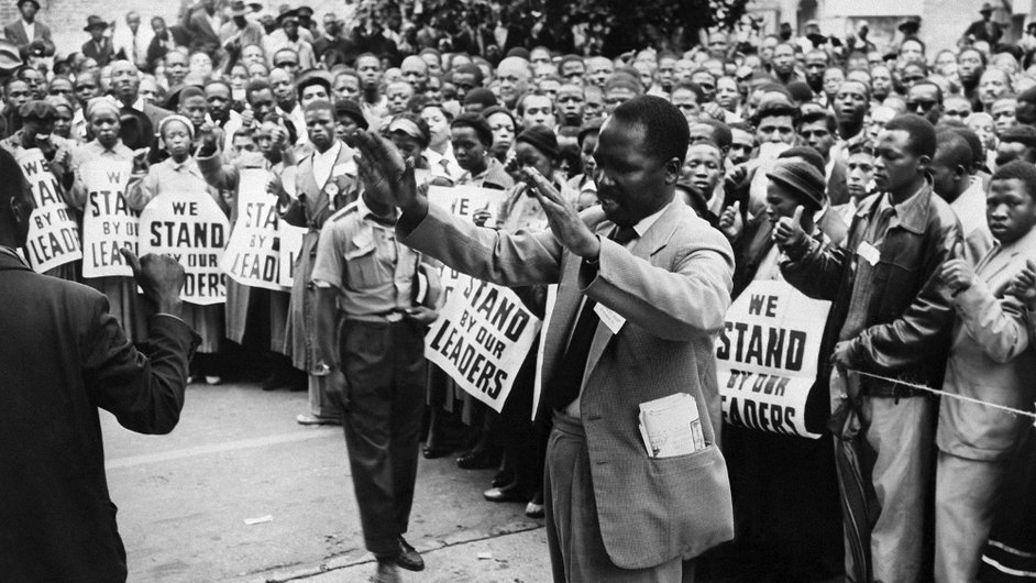 ANC supporters pray in front of the courthouse of Johannesburg in December 1956, to support 152 anti-apartheid militants, including Nelson Mandela, during their trial