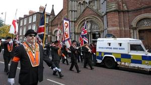 Orangemen march past St Patrick's Catholic Church in north Belfast