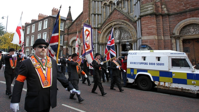 Orangemen march past St Patrick's Catholic Church in north Belfast