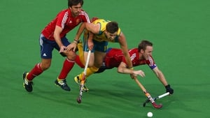 Australian hockey player Eddie Ockenden attempts to escape the attentions of Adam Dixon and Dan Shingles of England
