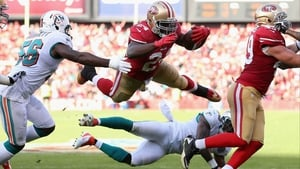 The San Francisco 49ers' Anthony Dixon goes airbourne