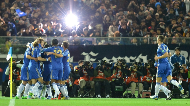 Chelsea players celebrate with Juan Mata after scoring his side's opener against Mexico's Monterrey
