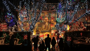 People gather to see a house in Melksham, England, all decked-out for Christmas