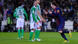 Lionel Messi of FC Barcelona celebrates after scoring his second goal against Real Betis, his 86th of 2012, beating the record for most goals scored in a single year