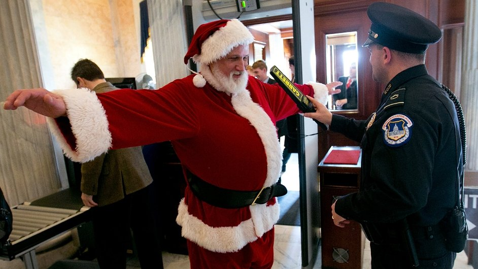 Police check a man dressed as Santa as he enters the US Capitol building on his way to Speaker of the House John Boehner's office
