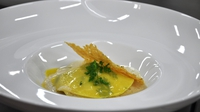 Stained glass open ravioli with langoustine - Served with a lemongrass and chervil veloute and a parmesan and truffle crisp