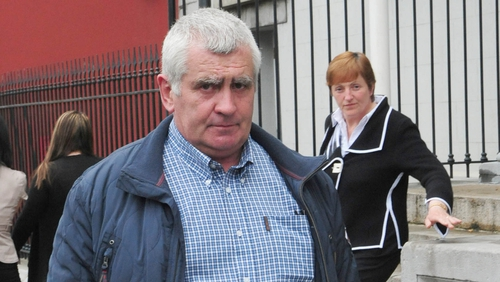 Donal Connaughton and his wife Margaret, seen in the background, are both facing multiple charges