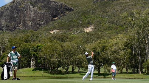 Leader Daniel Popovic playing a shot at the Palmer Coolum Resort's 13th hole