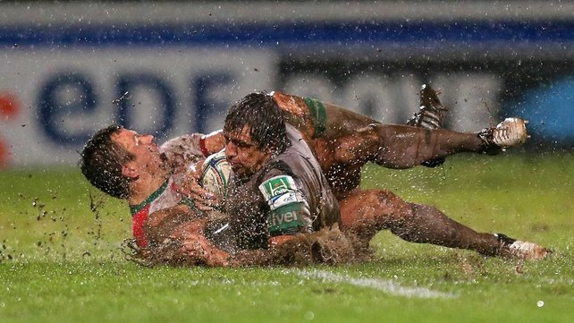 Biarritz's Damien Traille and Mike McCarthy of Connacht go sliding