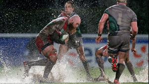 Connacht's Dan Parks tackles Erik Lund on a rainy night in Biarritz