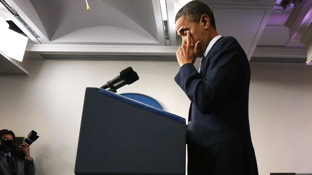 Barack Obama wipes away tears as he makes a statement in response to the elementary school shooting in Connecticut