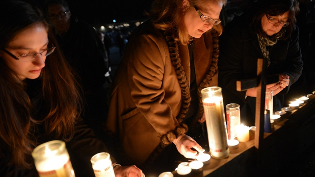 People gather for a prayer vigil at St Rose Church following an elementary school shooting in Newtown, Connecticut